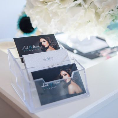 Close up of Lash and Brow Secrets business cards