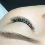 Top view of left eye with glamorous eyelash extensions